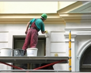 Execution of restoration works. The house painter behind work.